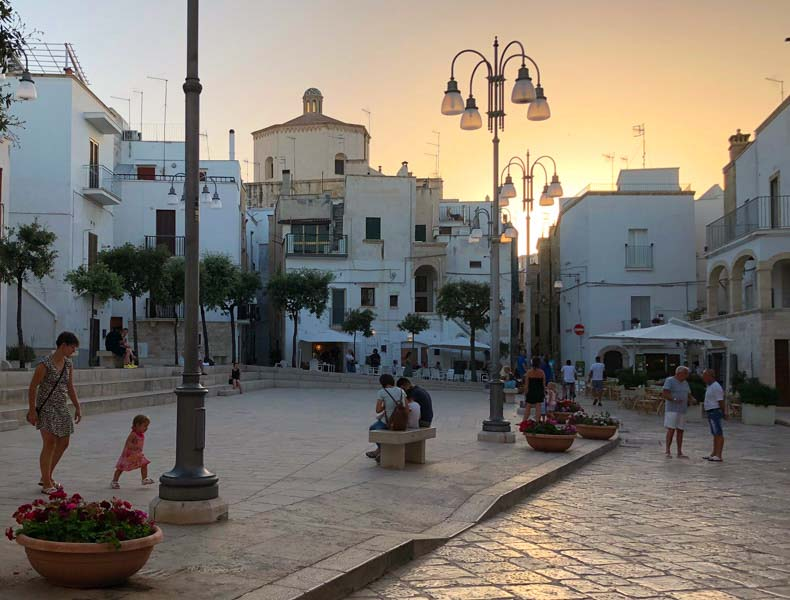 A piazza in Otranto at sunset