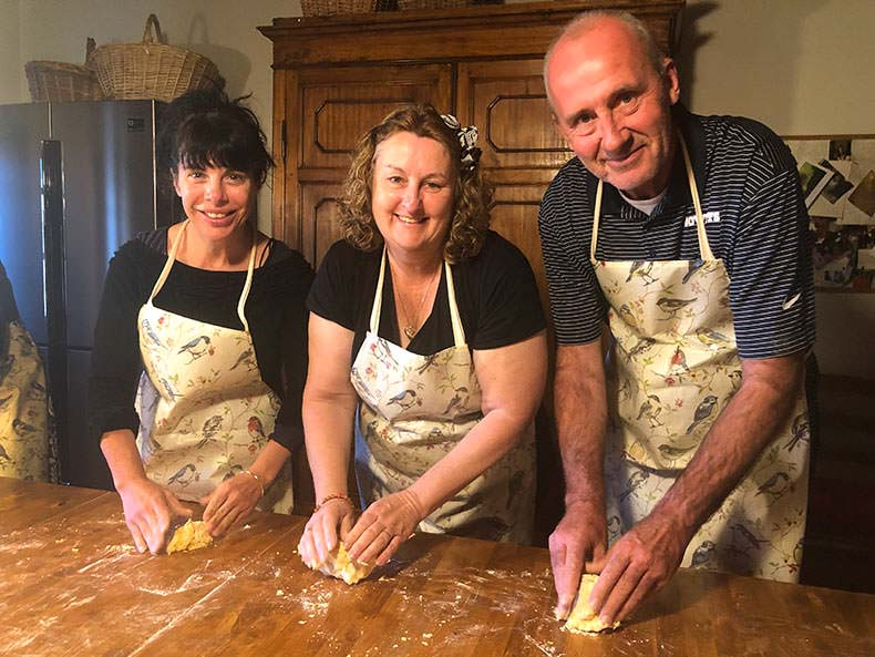 Three people at a cooking class in Tuscnay
