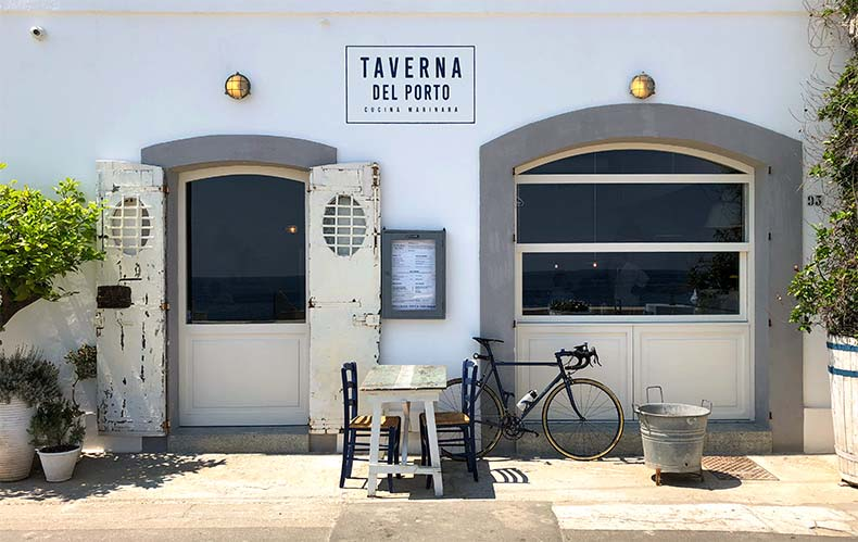 A white washed taverna in Puglia with a bicycles out the front