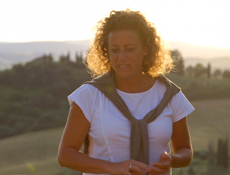 A lady standing in the Tuscan sunset