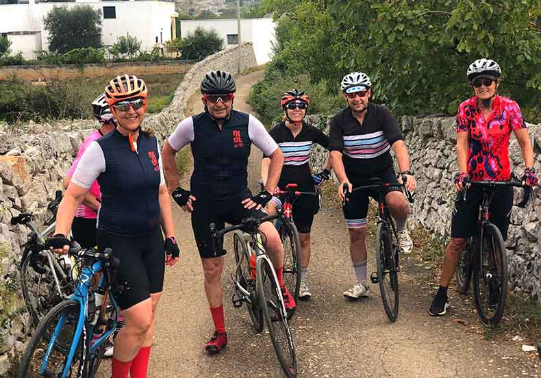 a group of cyclist on a small quiet road in Puglia