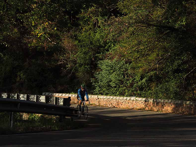 a cycling riding in Tusany