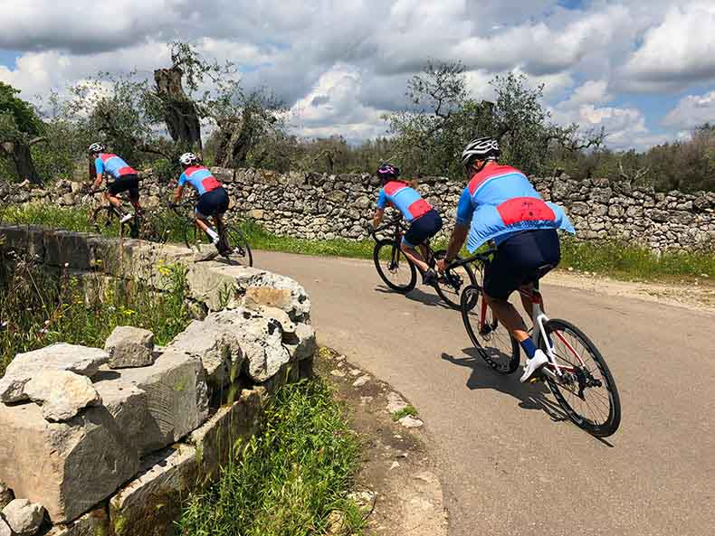 Cycling riding on the small quiet rock lined back roads of Puglia