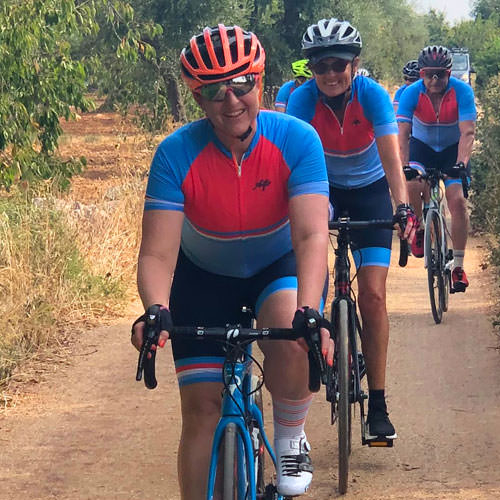 A group of riders on a quiet back road in Puglia